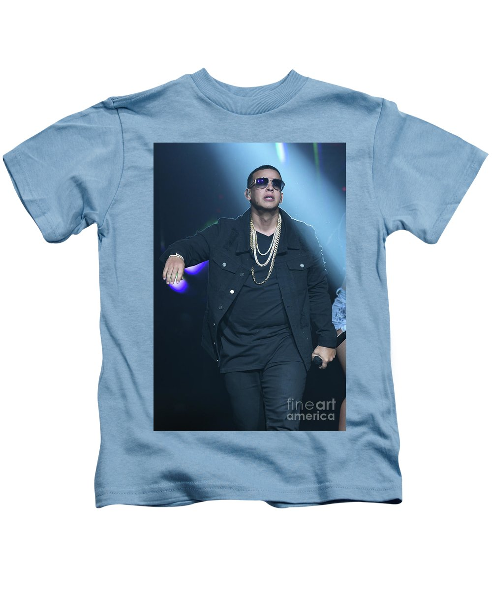 Singer Daddy_yankee Is Shown Performing During A Live Concert Appearance. Kids T-Shirt featuring the photograph Yankee_daddy by Concert Photos