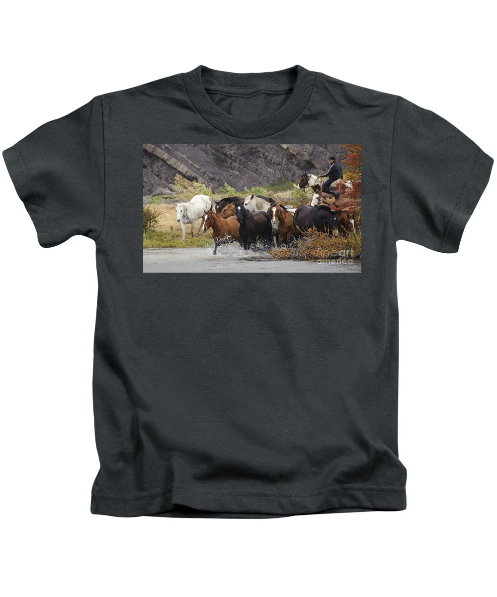 Horse Kids T-Shirt featuring the photograph Gaucho With Herd Of Horses by John Shaw