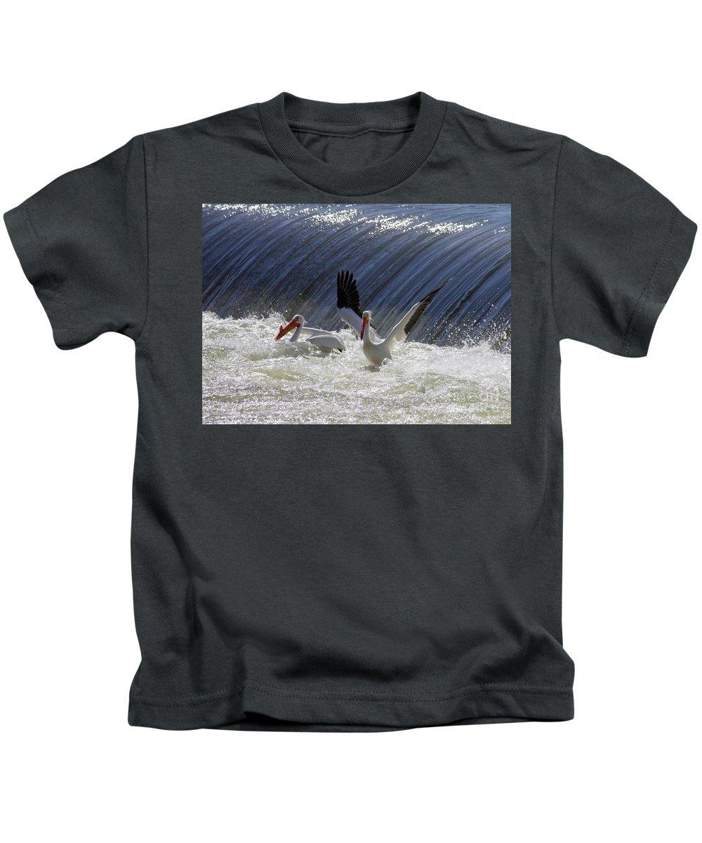 Kids T-Shirt featuring the photograph Pelican Drama by Carol Groenen