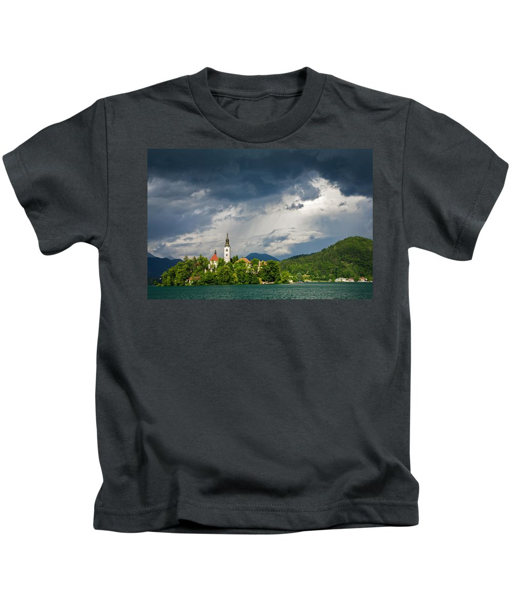 Bled Kids T-Shirt featuring the photograph Storm Light Over Lake Bled by Ian Middleton