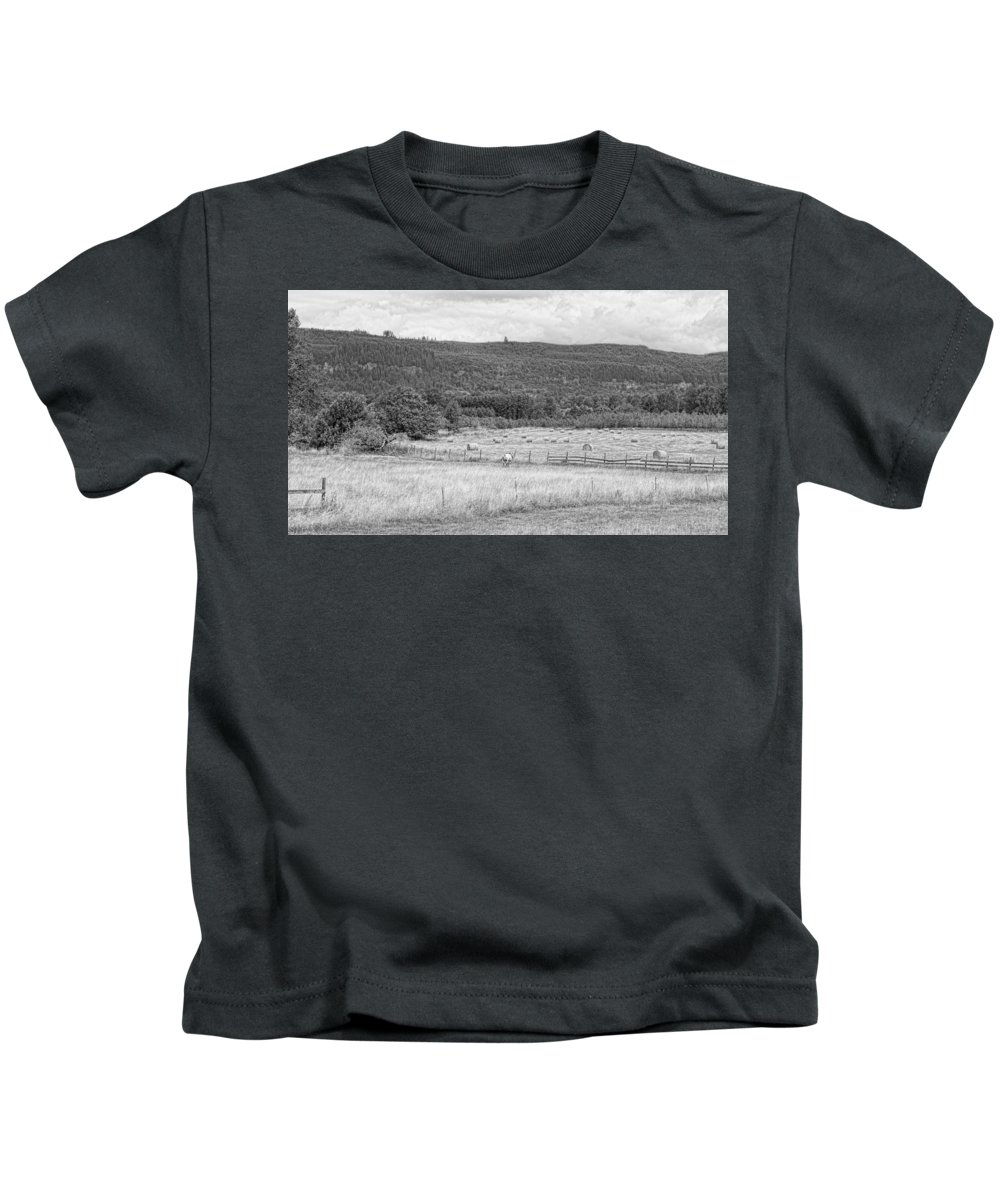 Kids T-Shirt featuring the photograph The Hay Field by Cathy Anderson