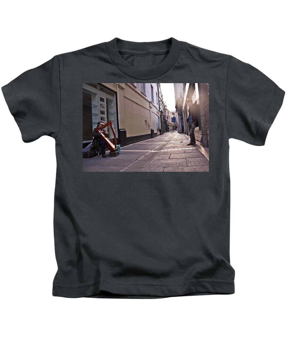 #street-art #street-music #harp #cityscape #dublin #ireland Kids T-Shirt featuring the photograph The Observer by Alex Art and Photo