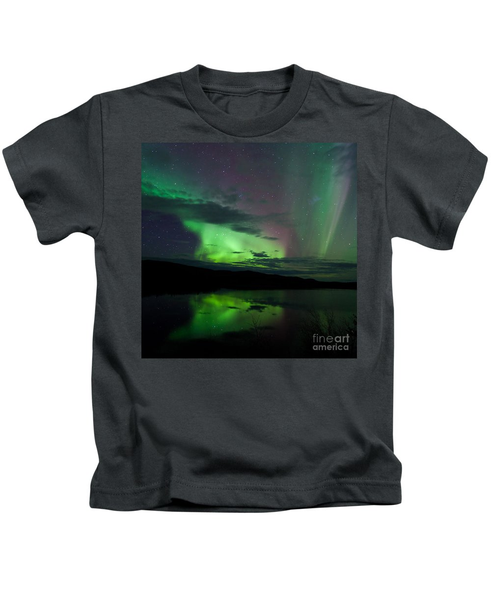 Above Kids T-Shirt featuring the photograph Night Sky Stars Clouds Northern Lights Mirrored by Stephan Pietzko