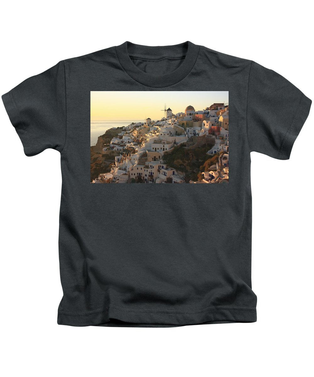 Aegean Kids T-Shirt featuring the photograph Oia At Sunset Santorini Cyclades Greece by Ivan Pendjakov