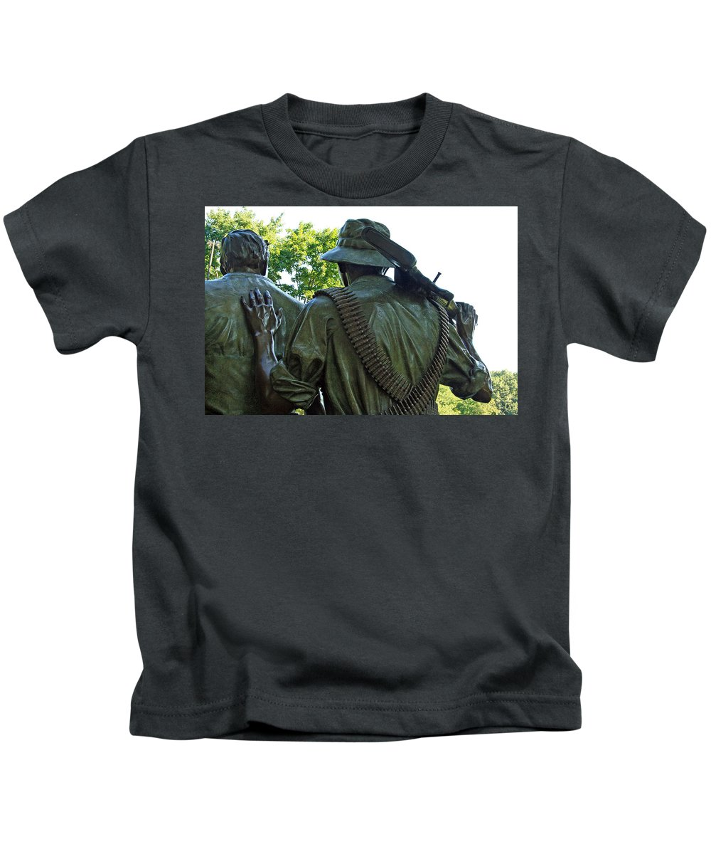 Three Soldiers Kids T-Shirt featuring the photograph A Soldier's Hand by Cora Wandel