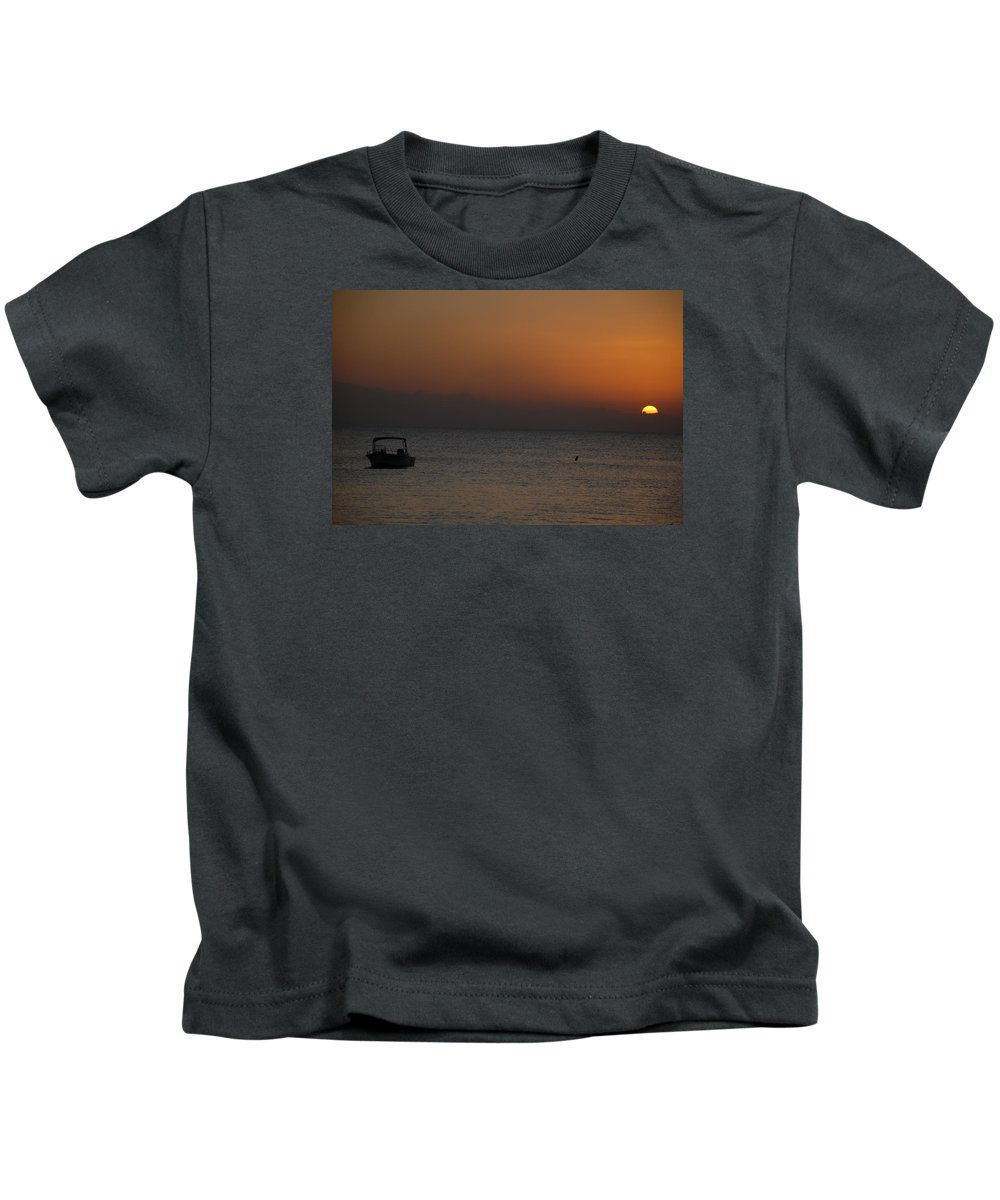 Photos Of The Cayman Islands Kids T-Shirt featuring the photograph Boat At Rest Sun Setting by Dave Byrne