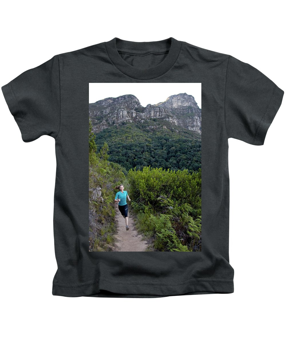 Adventure Kids T-Shirt featuring the photograph A Woman Running On One Of The Many by Lars Schneider