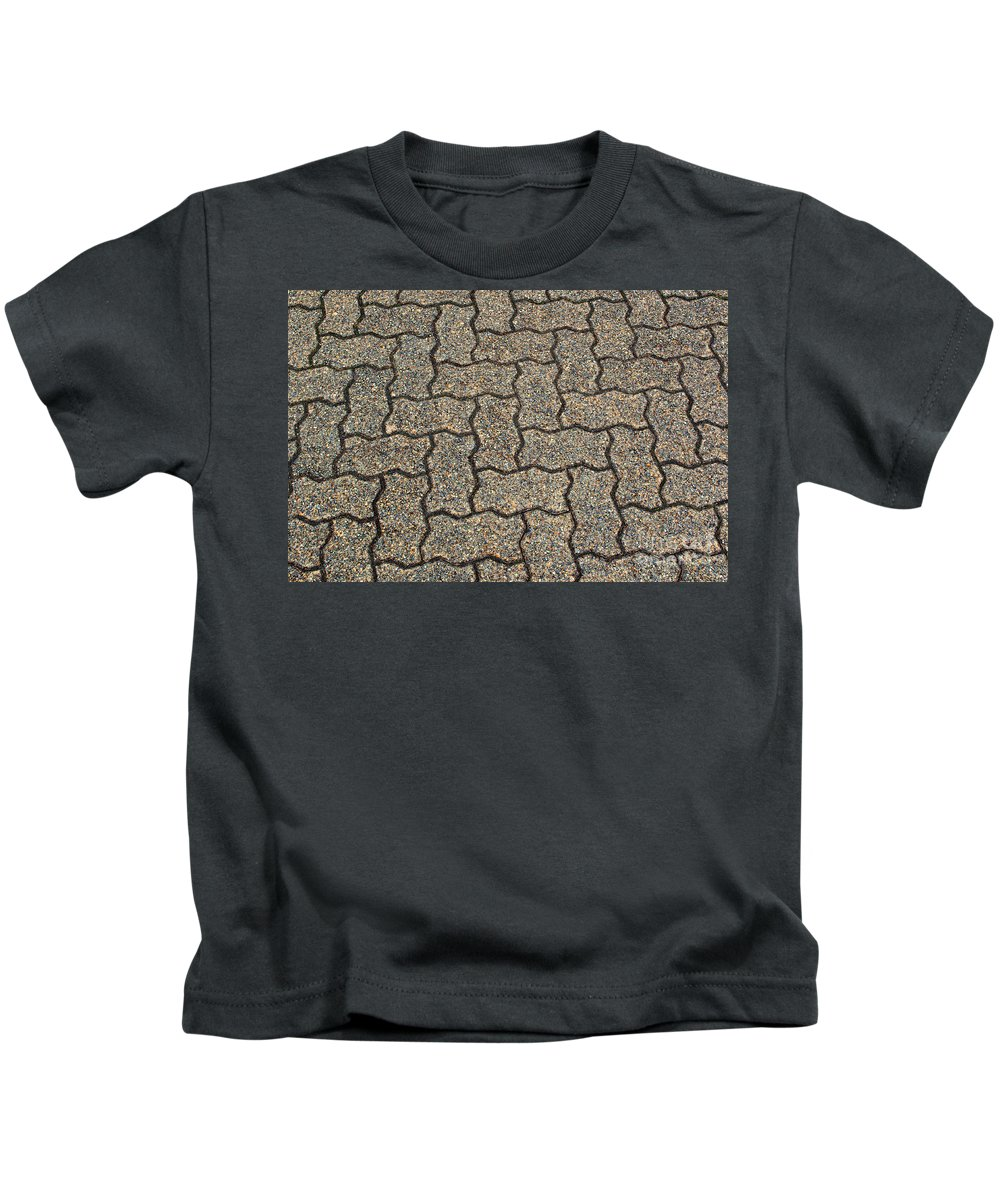 Backdrop Kids T-Shirt featuring the photograph Abstract Interlocking Pavement by Tikvah's Hope