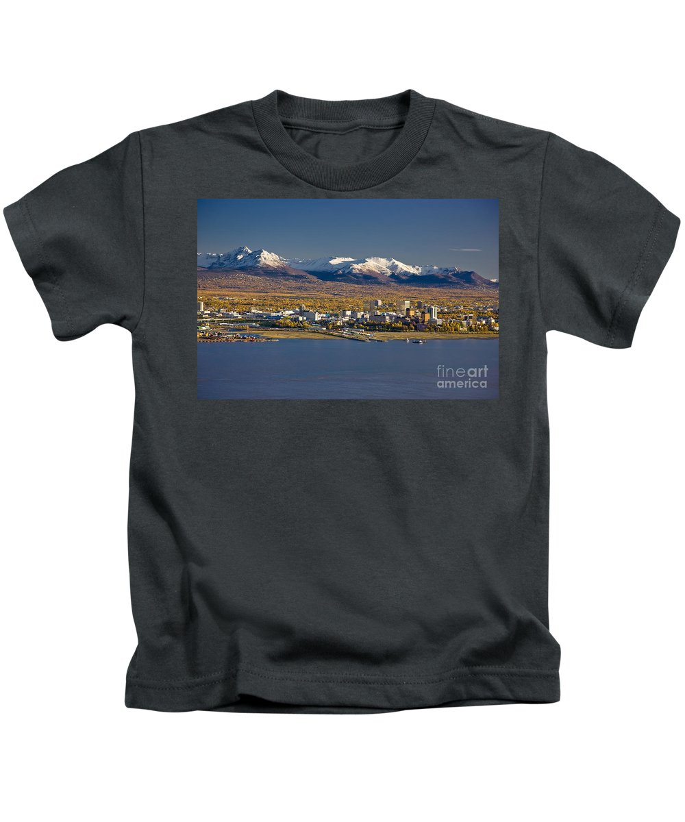 050710 Kids T-Shirt featuring the photograph Anchorage Skyline And The Chugach by Kevin G Smith