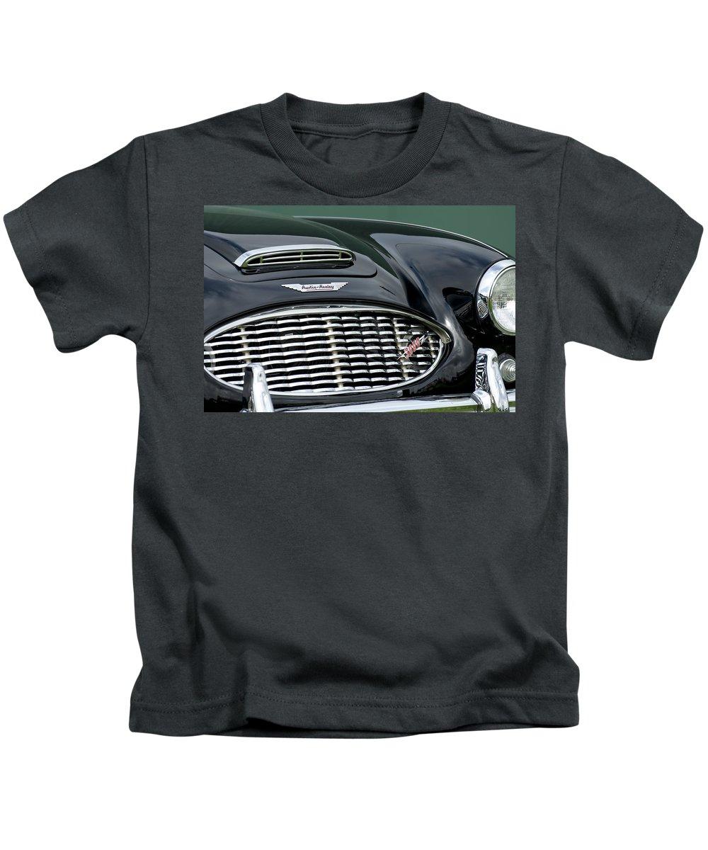 Austin-healey 3000 Kids T-Shirt featuring the photograph Austin-healey 3000 Grille Emblem by Jill Reger