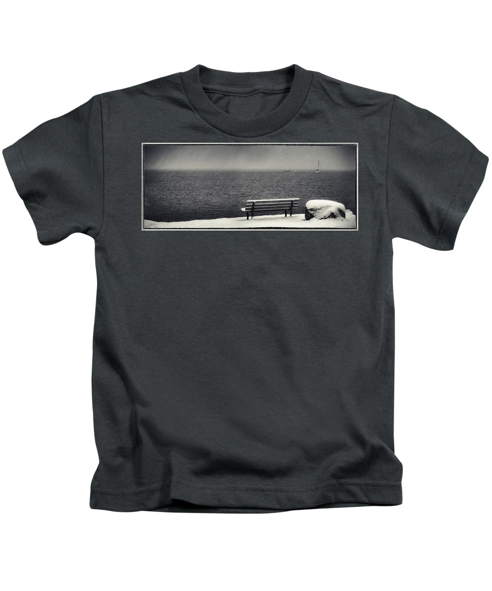 Bench Rock And Sailing Boat Kids T-Shirt featuring the photograph Bench On The Winter Shore by Peter v Quenter