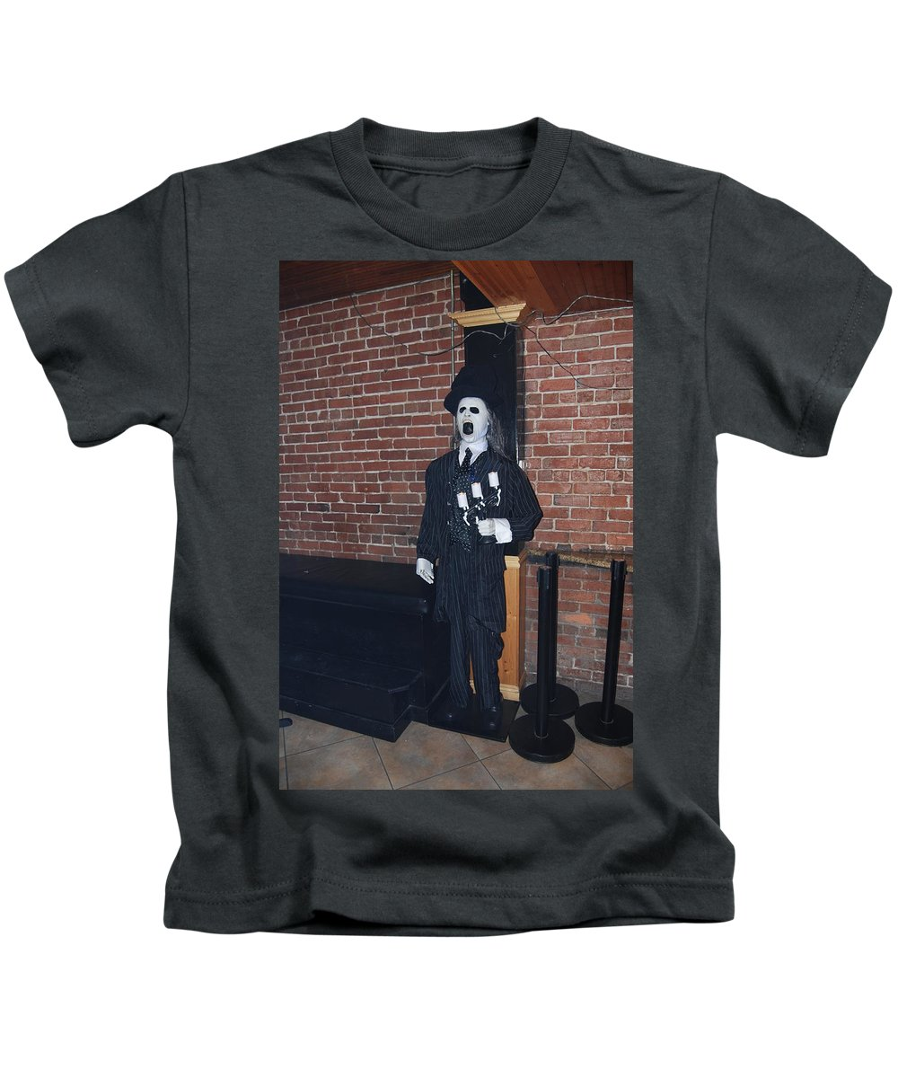 Welcome To Neo. Downtown Fort Myers Kids T-Shirt featuring the photograph Bouncer by Robert Floyd