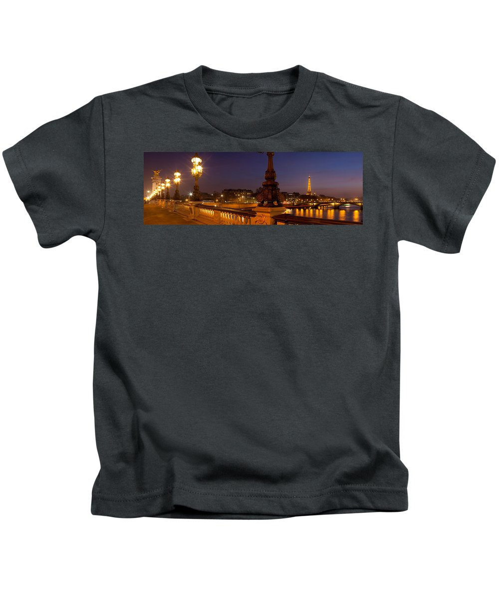 Photography Kids T-Shirt featuring the photograph Bridge Across The River Lit Up At Dusk by Panoramic Images