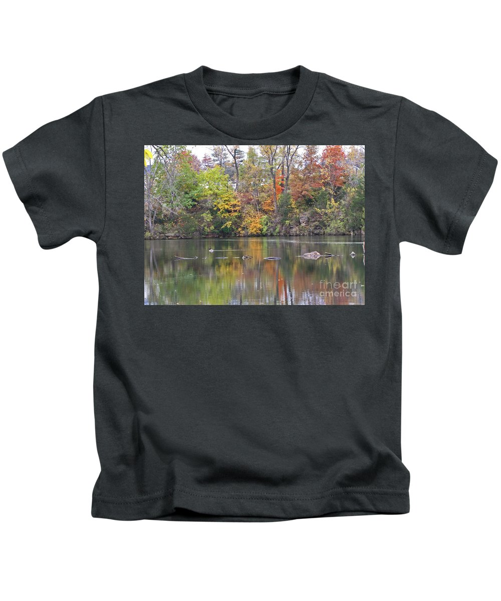 Autumn Kids T-Shirt featuring the photograph Canadian Goose Swimming Through The Autumn Reflections On The Pond by Minding My Visions by Adri and Ray