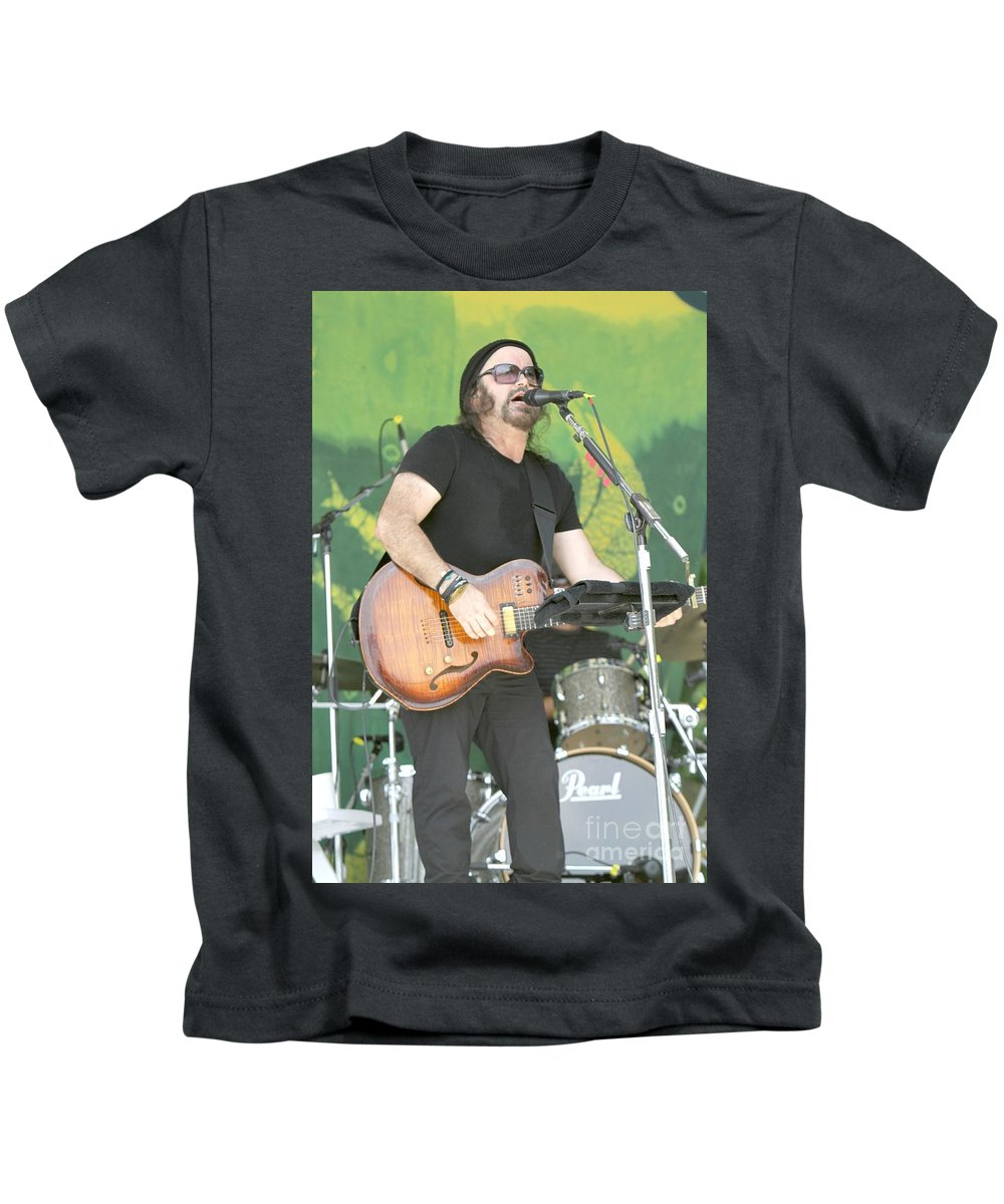 Performance Kids T-Shirt featuring the photograph Musician Carlos Varela by Concert Photos