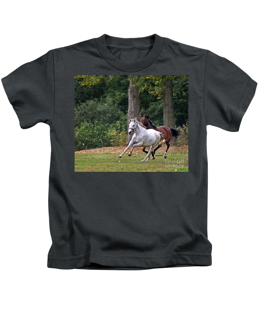 Horse Kids T-Shirt featuring the photograph Chasing The Wind by Angel Ciesniarska