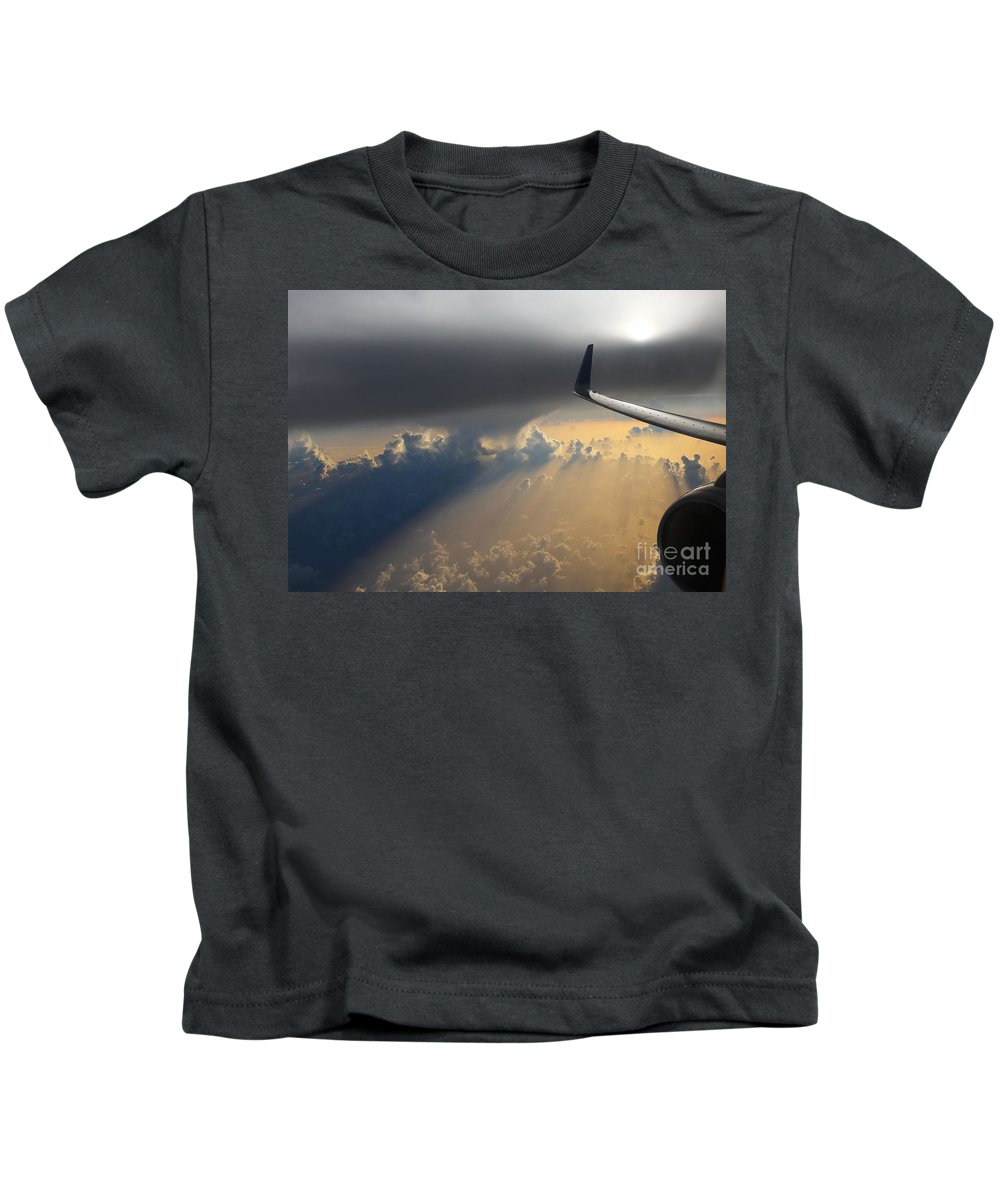 Airplane Kids T-Shirt featuring the photograph Coming thru the storm by Bob Hislop