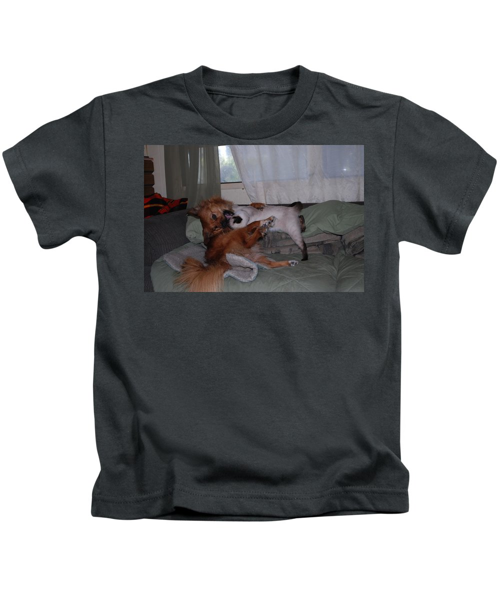 Lady Gets First Bite.ninja Grabs Lady. Dog Cat Kids T-Shirt featuring the photograph Death Grip by Robert Floyd