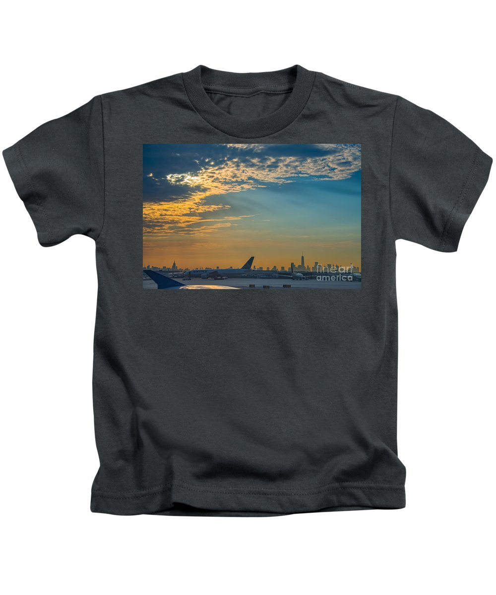 The Traveler Kids T-Shirt featuring the photograph Departing From Ewr by Michael Ver Sprill