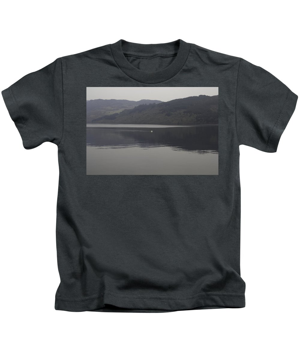 Action Kids T-Shirt featuring the photograph Distant View Of A White Goose Swimming Peacefully In Loch Ness by Ashish Agarwal