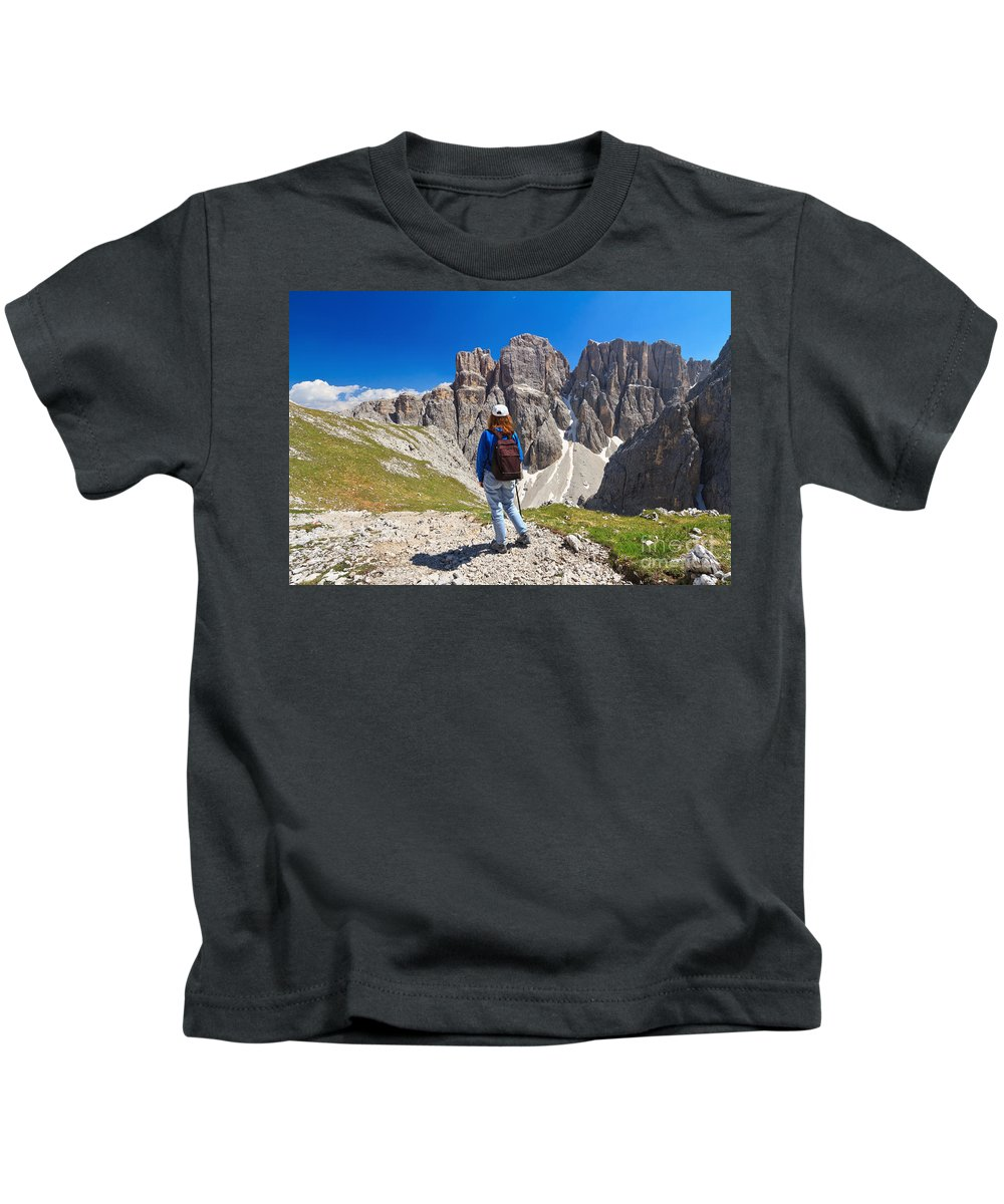 Hiker Kids T-Shirt featuring the photograph Dolomiti - Hiker In Sella Mount by Antonio Scarpi