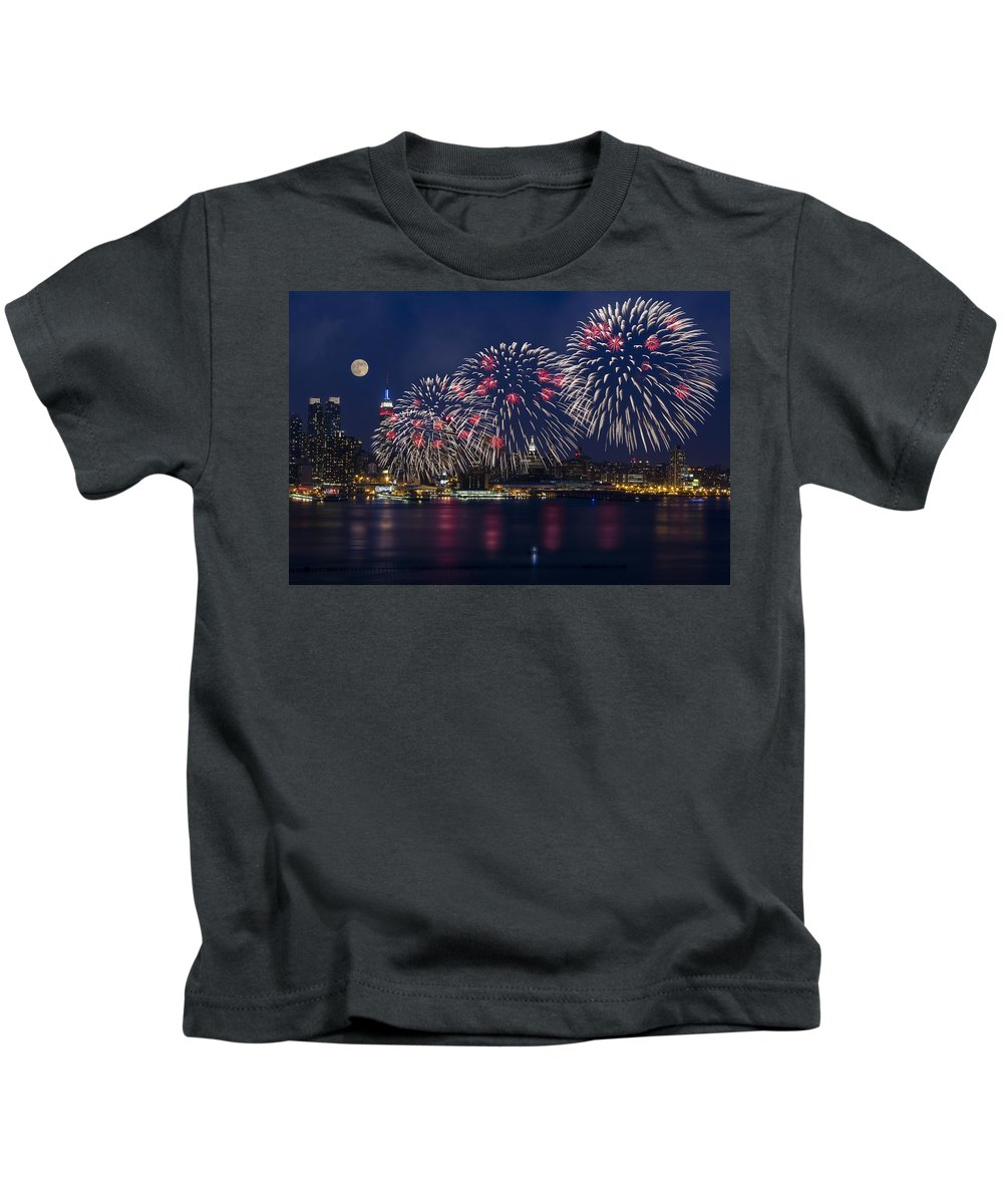 4th Of July Kids T-Shirt featuring the photograph Fireworks And Full Moon Over New York City by Susan Candelario