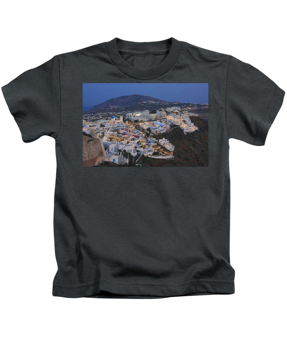 Aegean Kids T-Shirt featuring the photograph Firostefani At Night Santorini Cyclades Greece by Ivan Pendjakov