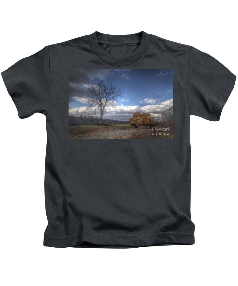 2014 Kids T-Shirt featuring the photograph Hay Bales On A Wagon by Larry Braun