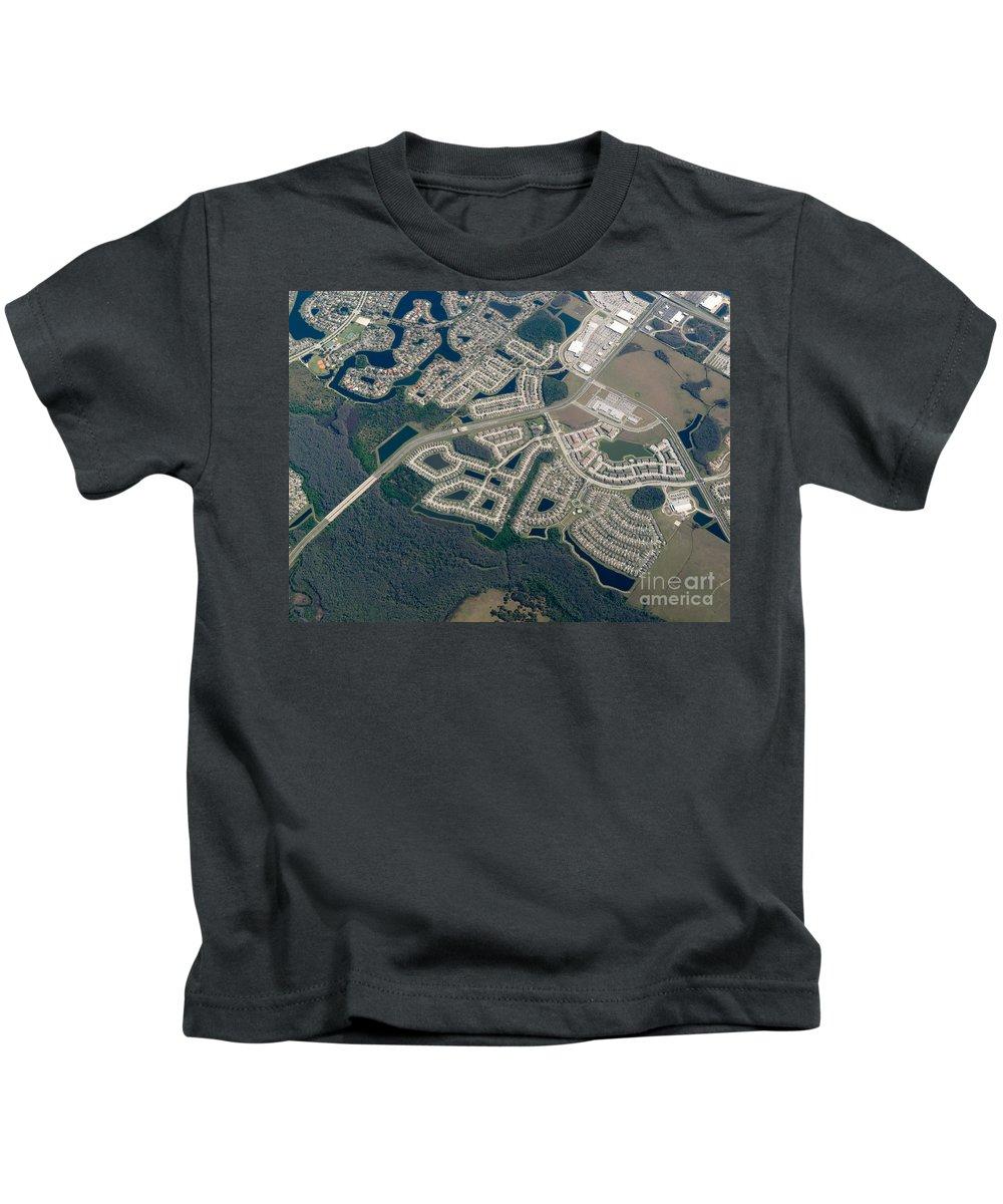 Aerial Kids T-Shirt featuring the photograph Housing Development Near Wetland by John Shaw