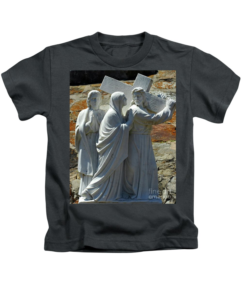 Jesus Kids T-Shirt featuring the photograph Jesus Carrying Cross by Kathleen Struckle