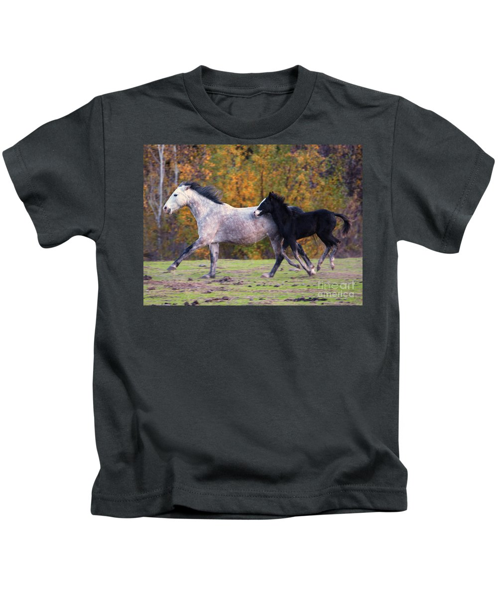Mustang Kids T-Shirt featuring the photograph Keeping Up by Mike Dawson