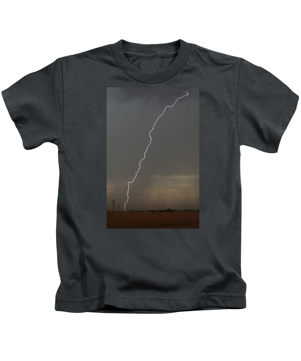 Lightning Kids T-Shirt featuring the photograph Lightning Strike In Texas by Ed Sweeney
