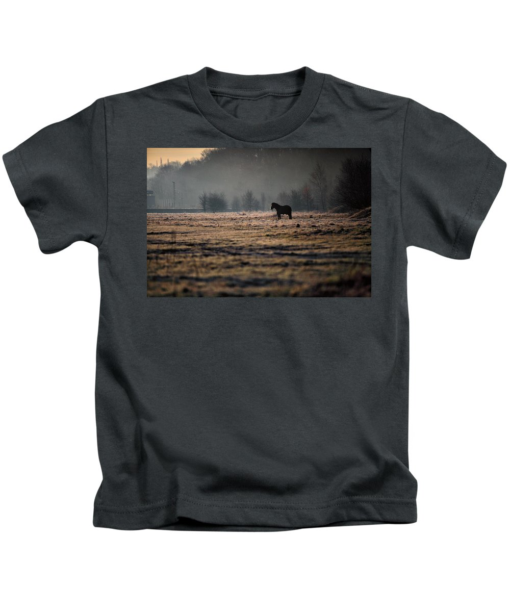 Sunrise Kids T-Shirt featuring the photograph Lone Horse by Russ Dixon