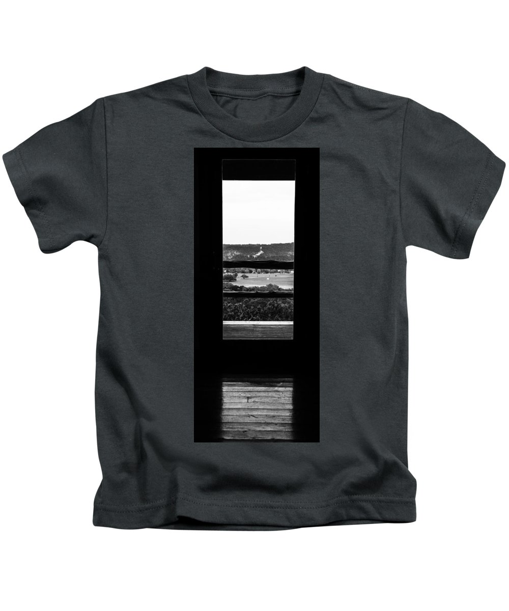 Wimberly Trip 2013 Kids T-Shirt featuring the photograph Looking Out A Country Door. by Darryl Dalton