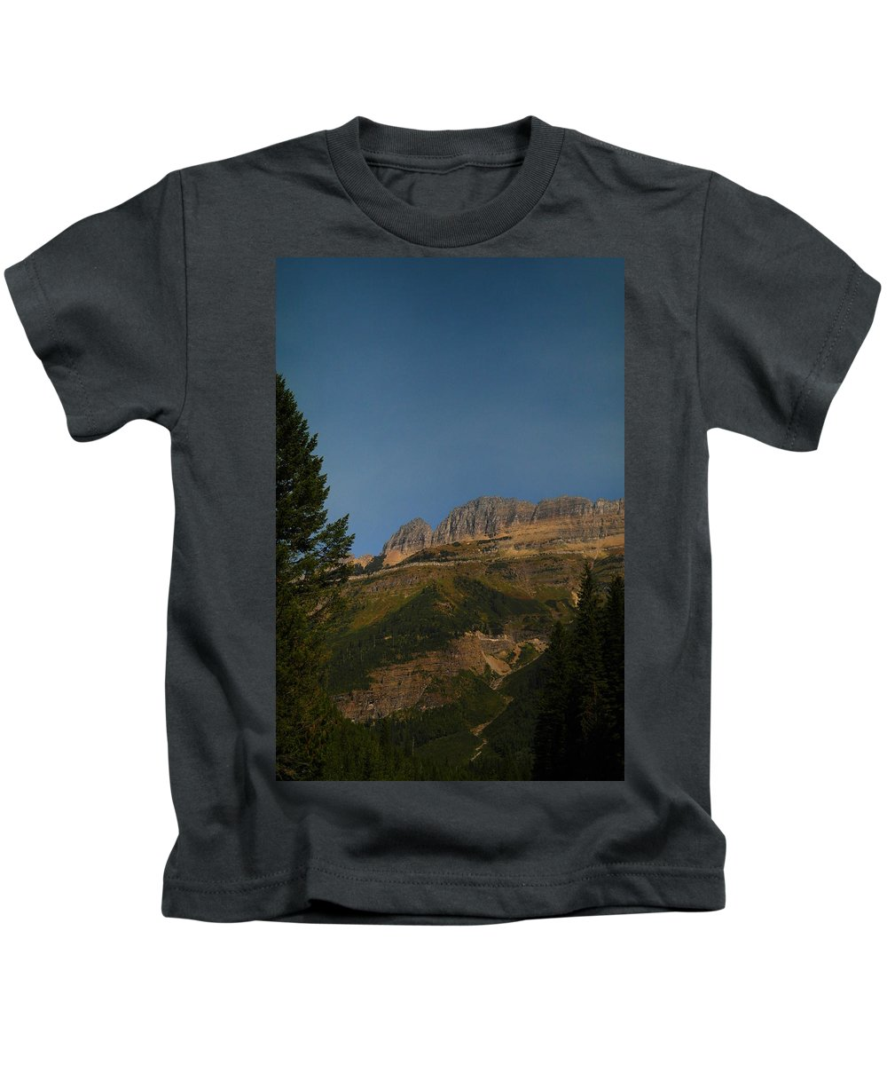 Glacier National Park Kids T-Shirt featuring the photograph On The Going To The Sun Road by Jeff Swan