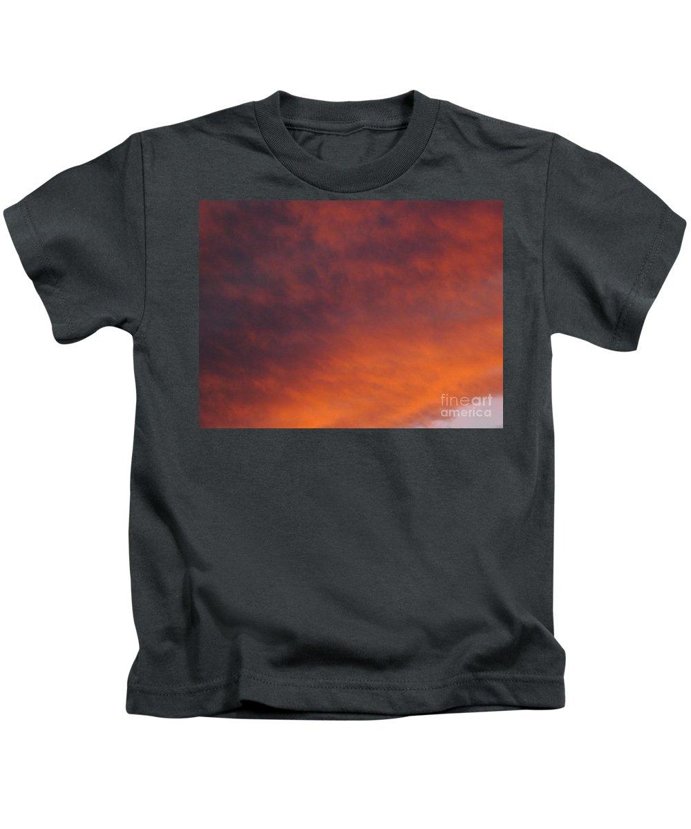 Sunset Kids T-Shirt featuring the photograph Orange Clouds At Sunset by Jussta Jussta