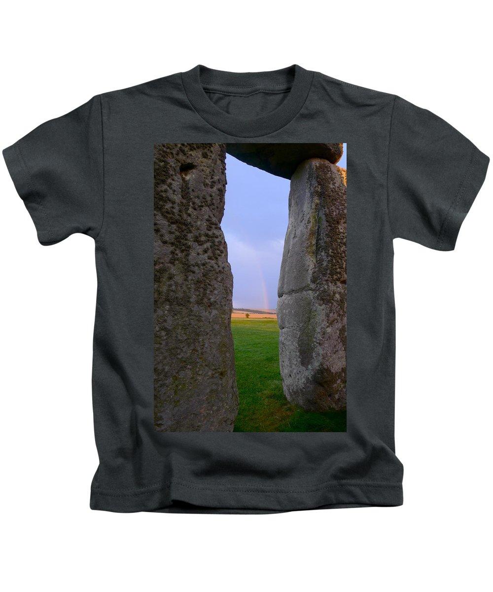 Stonehenge Kids T-Shirt featuring the photograph Rainbow Through Stonehenge Sarsens by Denise Mazzocco