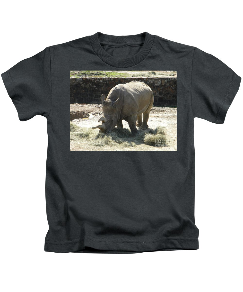 Rhino Kids T-Shirt featuring the photograph Rhino Eating by Nathanael Smith