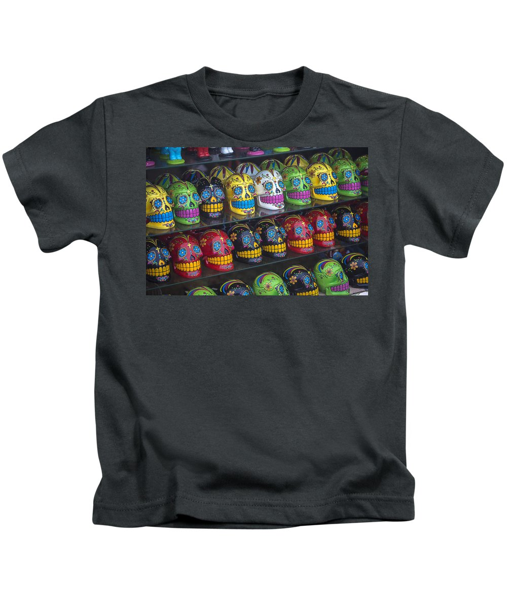 Rows. Row Kids T-Shirt featuring the photograph Rows Of Skulls by Garry Gay