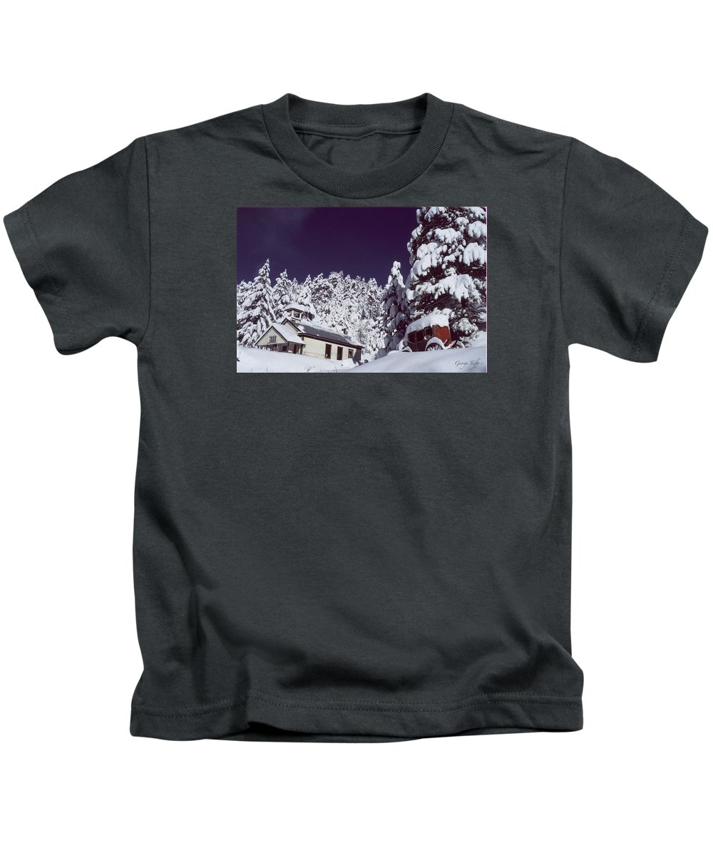 Schoolhouse History Colorado Nature Stagecoach Winter Snow Rocky Mountains Kids T-Shirt featuring the photograph Schoolhouse by George Tuffy