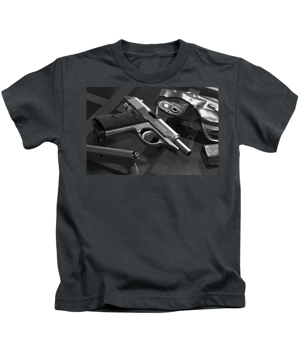Ppk Kids T-Shirt featuring the photograph The Smoking Gun by Brian Caldwell