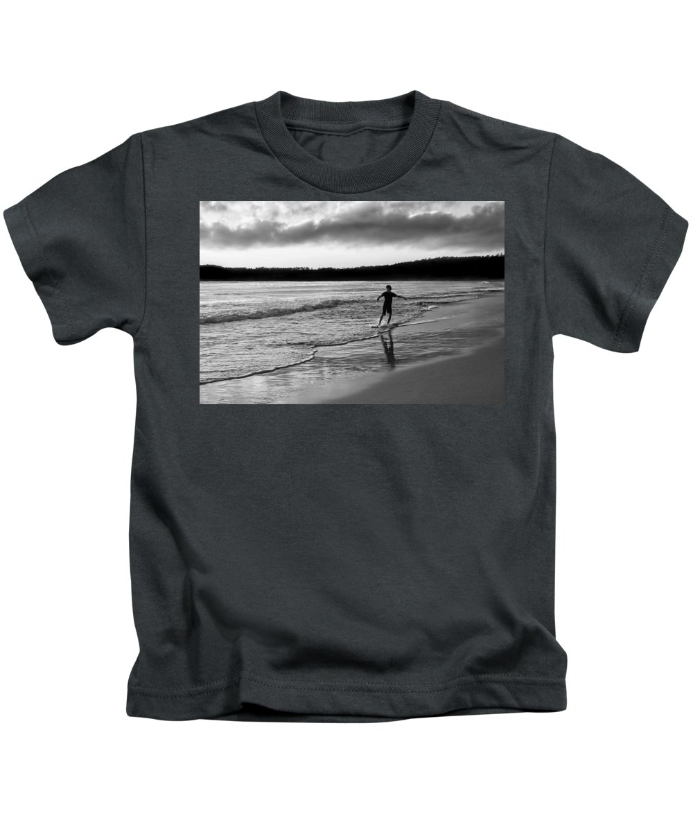 Skimboarding Kids T-Shirt featuring the photograph Skimboarder Sunser #1 - Black And White by Nikolyn McDonald