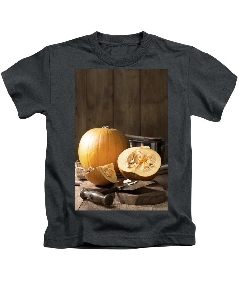Pumpkin Kids T-Shirt featuring the photograph Slicing Pumpkins by Amanda Elwell