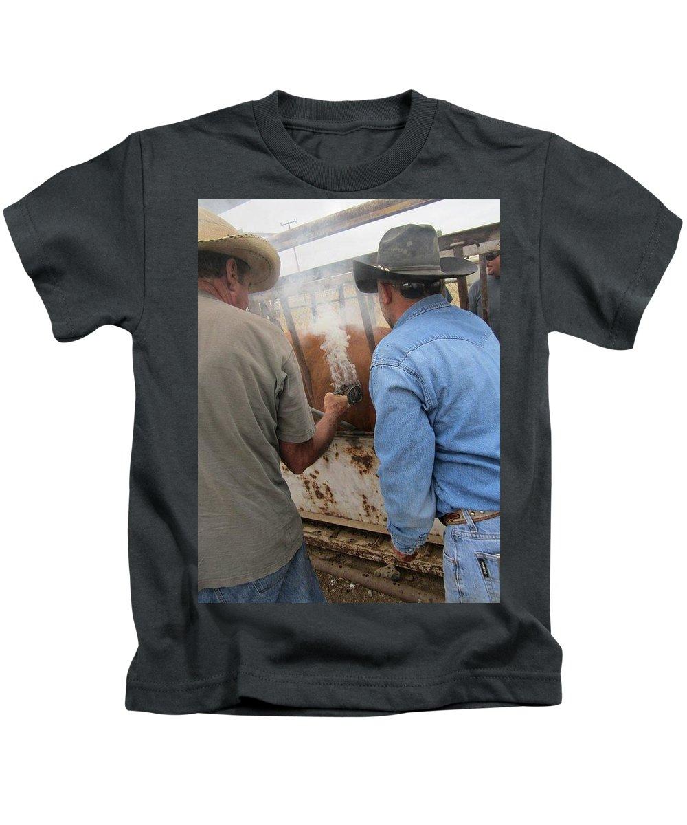 Brand Kids T-Shirt featuring the photograph Smokin Brand by Steve Scheunemann
