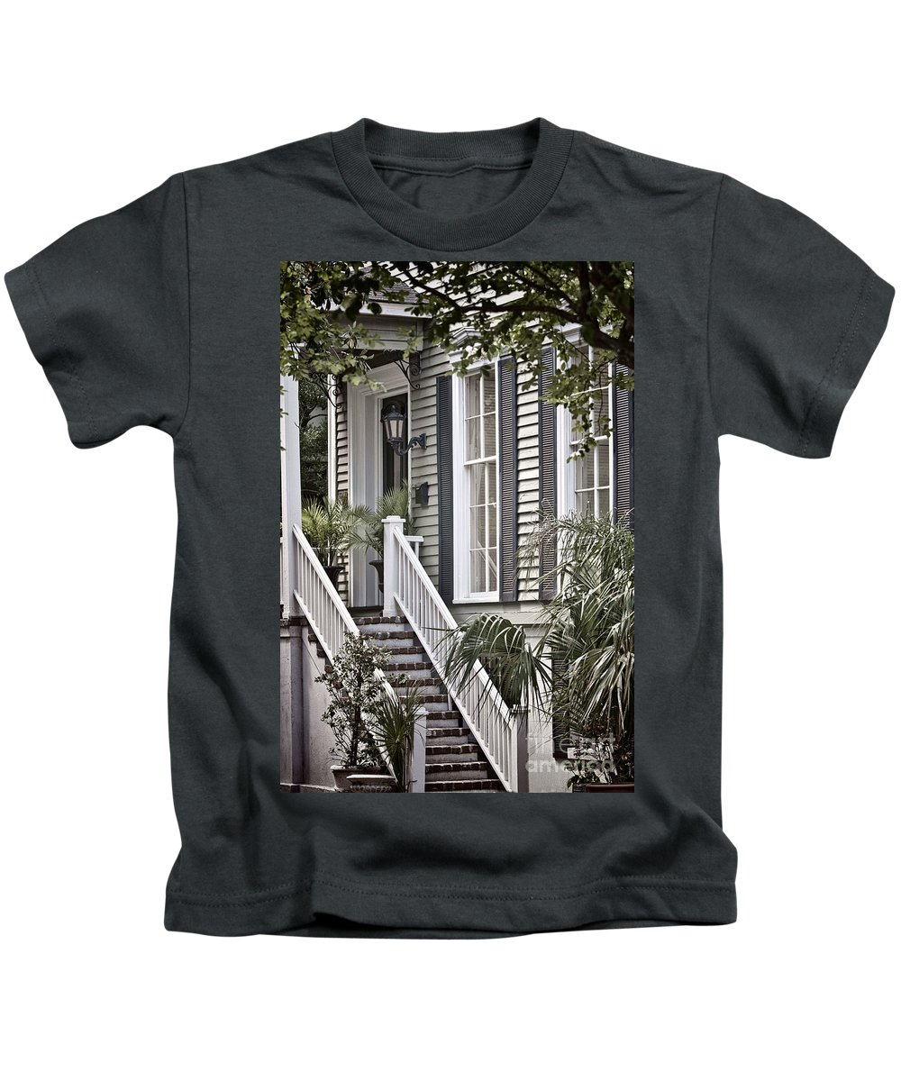 House; Home; Exterior; Outside; Outdoors; Steps; Stairs; Staircase; Brick; Wood; Rail; Railing; Side; Windows; Siding; Door; Light; Entrance; Facade; Entry; Plants; Green; Nature; Trees; Welcome; Lovely; Beautiful Kids T-Shirt featuring the photograph Step Up by Margie Hurwich