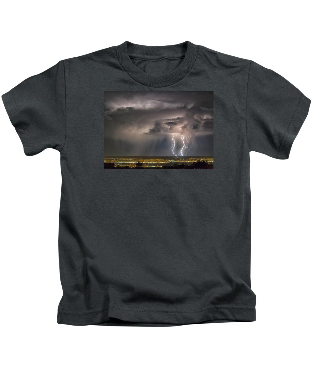 New Mexico Kids T-Shirt featuring the photograph Storm Over Albuquerque by Alan Toepfer