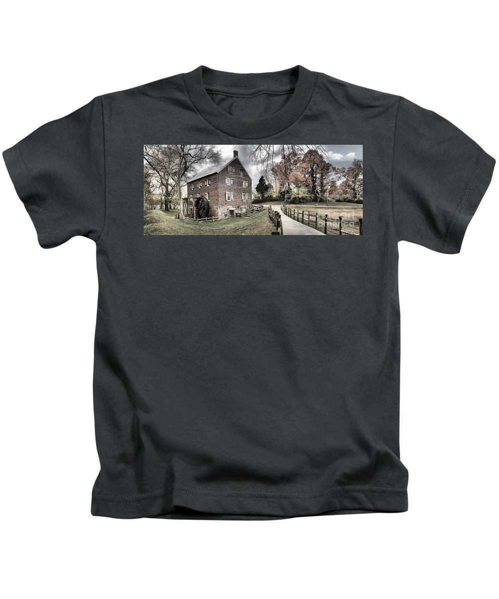 Grist Mill Kids T-Shirt featuring the photograph Stormy Skies Over The 1823 Grist Mill by Adam Jewell