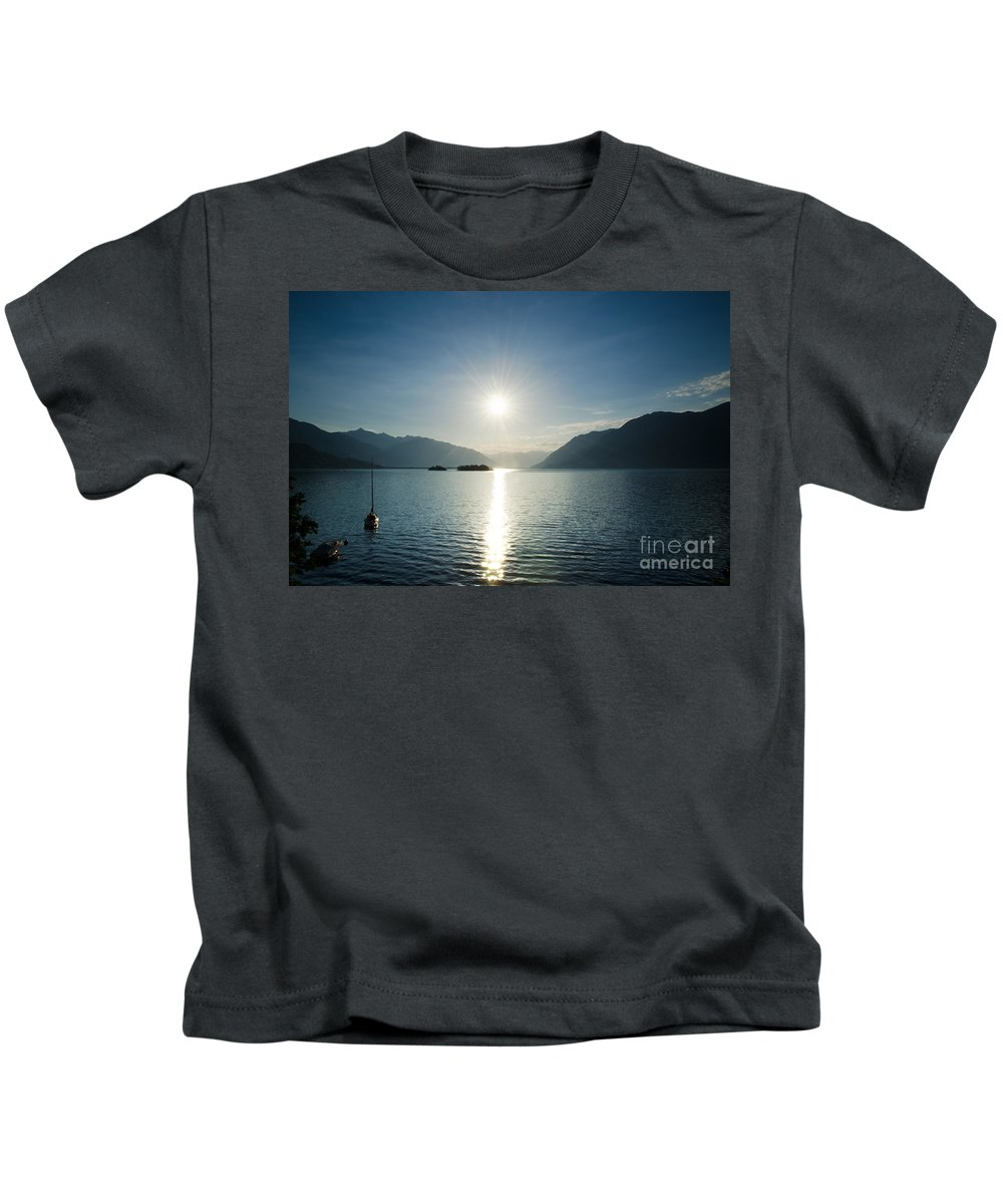 Sunrise Kids T-Shirt featuring the photograph Sunrise Reflected Over An Alpine Lake by Mats Silvan