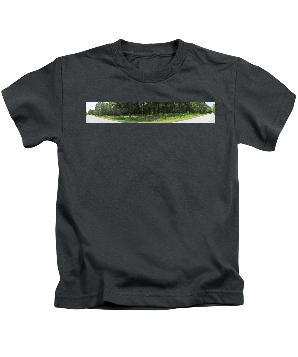 Panorama Kids T-Shirt featuring the photograph The Woods And The Road From The Series The Imprint Of Man In Nature by Verana Stark
