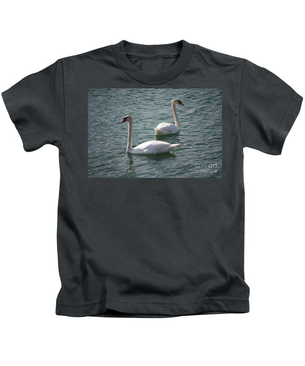 Nature Kids T-Shirt featuring the photograph Two Swans A Swimming by Brook Steed